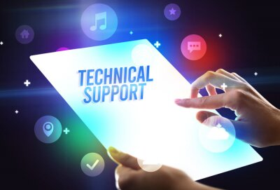 Holding futuristic tablet with TECHNICAL SUPPORT inscription, new technology concept