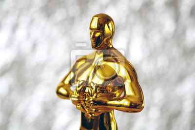 Bild Hollywood  Golden Oscar Academy award statue on silver background. Success and victory concept.
