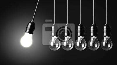 Bild Idee, Konzept auf schwarz. Perpetuum mobile mit Glühbirnen
