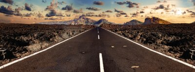 Bild Image related to unexplored road journeys and adventures.Road through the scenic landscape to the destination in Lanzarote natural park