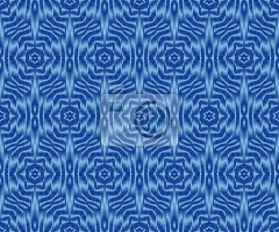 Indigo dyed ikat seamless pattern. Elegant patterned fabric texture.