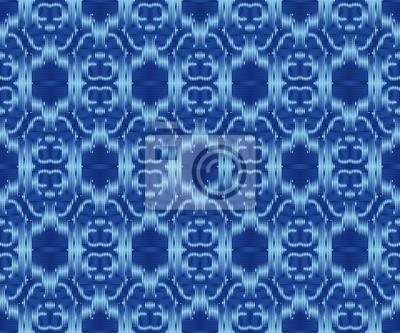 Indigo dyed textile seamless pattern. Original ikat stylish background.