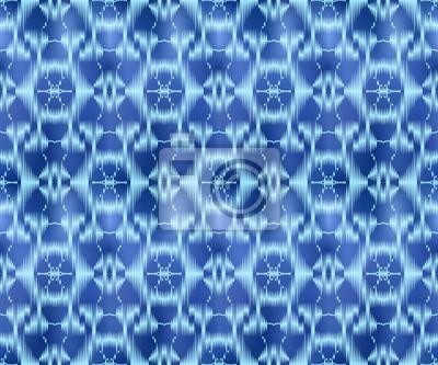 Indigo dyed textile seamless pattern. Repeatable ikat background.