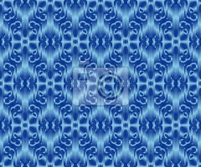 Bild Indigo dyed textile seamless pattern. Repeatable ikat stylish ornament.