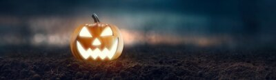 Bild Jack O 'Lantern with creepy glowing eyes on Halloween night