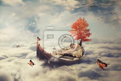 Bild Junge einsame schöne Frau treibt auf einem Boot über Wolken. Verträumte Bildschirmschoner