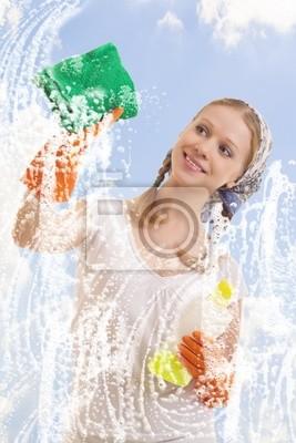 Bild Junge Frau wäscht Fenster