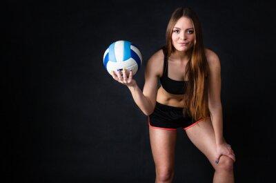 Bild Junge Mädchen, die Volleyball auf schwarzem Hintergrund