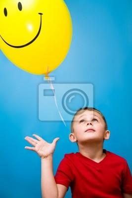 Junge und Ballon