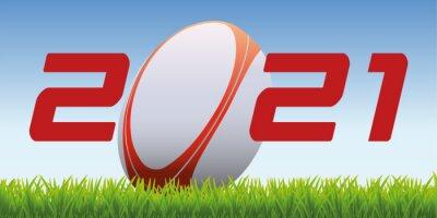 L'année 2021 avec un ballon de rugby posé sur la pelouse d'un terrain pour symboliser le lancement de la nouvelle saison de compétition.