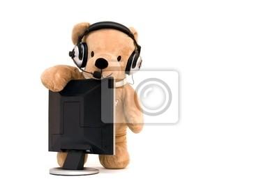 Laptop-Computer und Teddybär