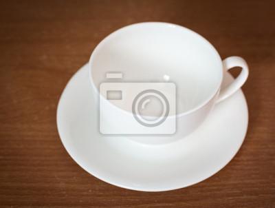 Bild Leere Kaffeetasse auf alten Holztisch. Selektiver Fokus.