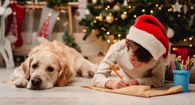 Bild Little boy writing letter to santa