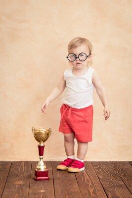 Lustiger Sportler des Babys. Erfolgs- und Gewinnerkonzept