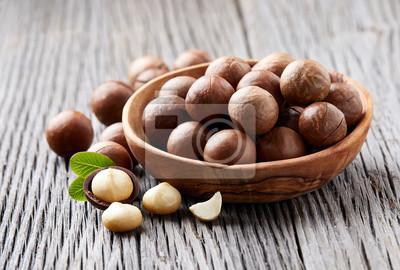 Bild Macadamia nuts on wooden background