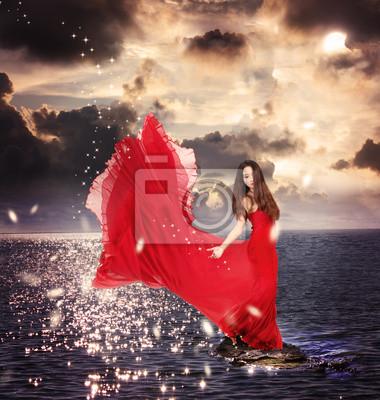 Mädchen im roten Kleid, auf dem Ocean Rocks