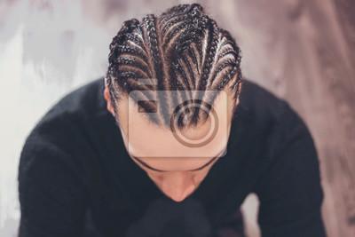 Bild male hairstyle close-up braids, hair braided, pensive look, man portrait