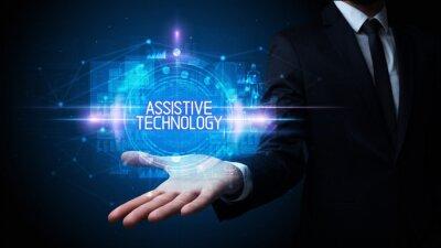 Man hand holding ASSISTIVE TECHNOLOGY inscription, technology concept