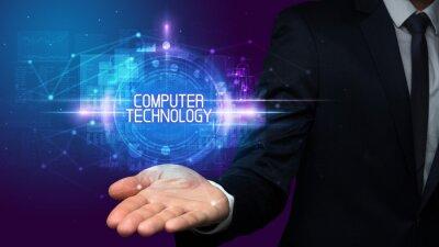 Man hand holding COMPUTER TECHNOLOGY inscription, technology concept
