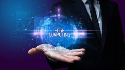 Man hand holding EDGE COMPUTING inscription, technology concept