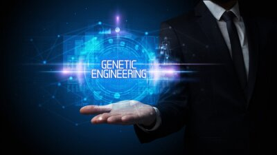 Man hand holding GENETIC ENGINEERING inscription, technology concept