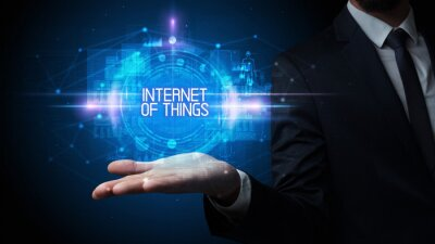 Man hand holding INTERNET OF THINGS inscription, technology concept