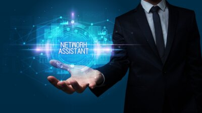 Man hand holding NETWORK ASSISTANT inscription, technology concept