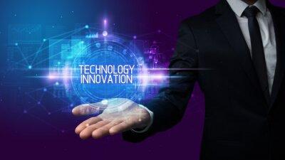 Man hand holding TECHNOLOGY INNOVATION inscription, technology concept