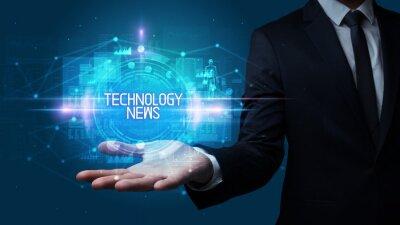 Man hand holding TECHNOLOGY NEWS inscription, technology concept