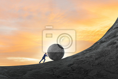 Bild Man pushing large stone to the top