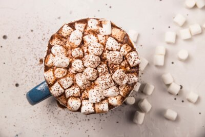 Bild Marshmallow in a cup of hot chocolate or cocoa on a gray table.