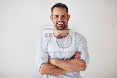 Bild Mature entrepreneur standing with arms crossed on a white backgr