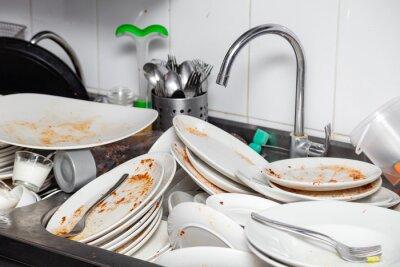 Bild Metal sink full of dirty dishes, crockery, tableware