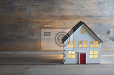 Bild Miniature house over a wooden background