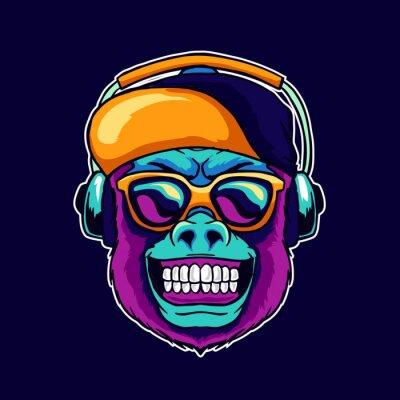 Bild Monkey smile wear cool glasses and cap hat listening dope music on the headphone speaker vector illustration. Pop art color style animal gorilla head logo design for creative DJ sound producer studio.