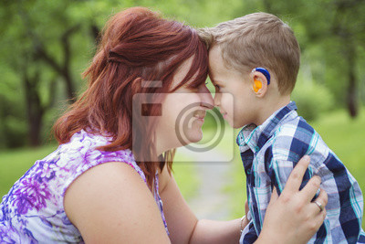 Bild Mother and son in forest having fun
