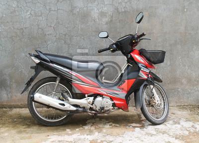 Bild Motorrad / Schwarz Und Rot Motorrad Auf Dem Hintergrund Der Grauen Wand