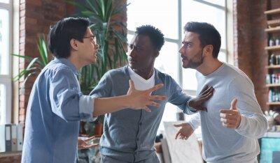 Bild Multiracial coworkers having quarrel in office, conflict of interest
