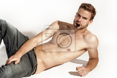 Bild Muscle strong beautiful stripped male model in denim jeans on white isolated font background with shadow