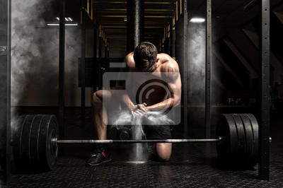 Muscular man clapping hands and preparing for workout