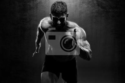Bild Muscular Men in Running Motion. Handsome Male Athlete Sprinting