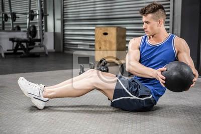 Muskuläre Mann Ausbildung mit Medizin Ball