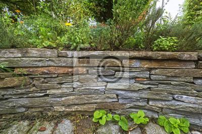 Natursteinmauer Mit Hochbeet Im Garten Leinwandbilder Bilder