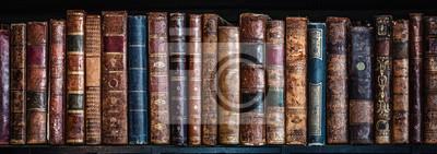 Bild Old books on wooden shelf. Tiled Bookshelf background.  Concept on the theme of history, nostalgia, old age. Retro style.