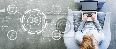 Bild Online education concept with man using a laptop in a modern gray chair