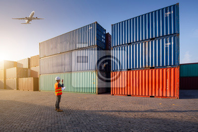 Bild Operator control at the port, loading containers for trucks for export and importing logistic background, control staff in Asia, loading containers for trucks for export and import.