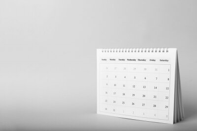 Bild Paper calendar on grey background, space for text. Planning concept