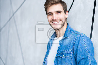 Bild Perfect man. Portrait of happy fashionable handsome man in jeans shirt.