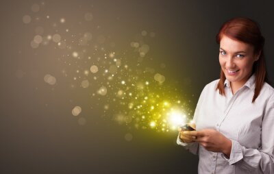 Bild Person using phone with gold sparkling concept