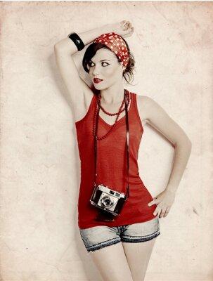 Pin -up- Mädchen mit einer Kamera
